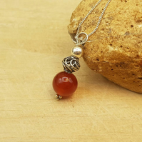 Minimalist Red Carnelian sphere pendant. July birthstone necklace