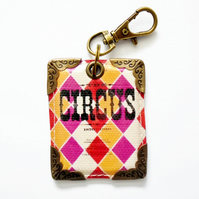 keyring, keychain, purse charm, bag charm, vintage circus, book cover.