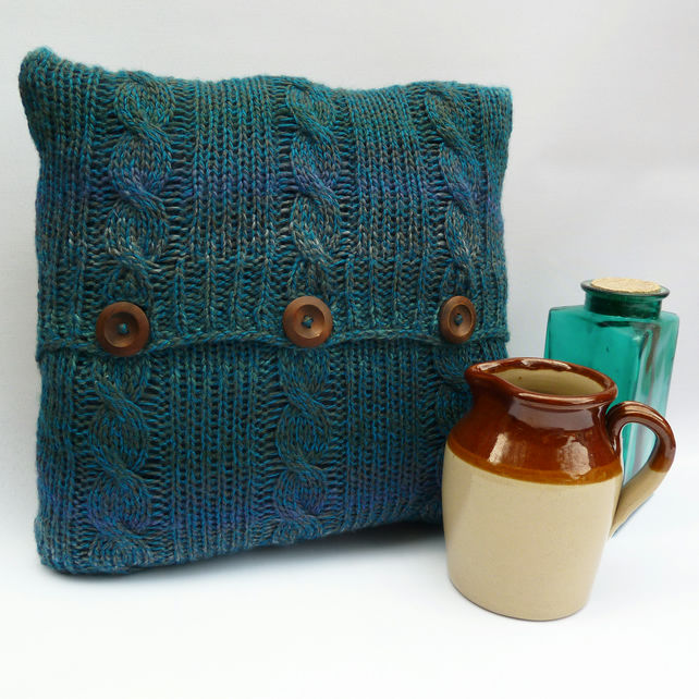 Teal cable knitted cushion