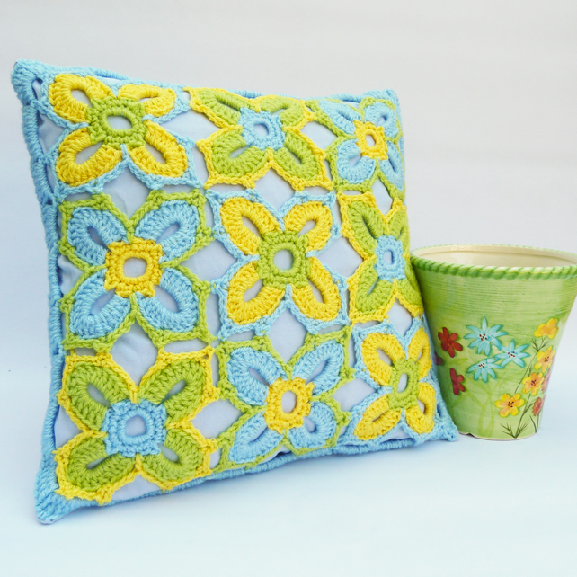 Blue, green and yellow crochet cushion