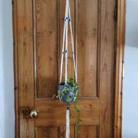 Macramé plant hanger with blue beads
