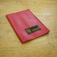 Red leather passport cover with strawberries