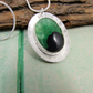 Green and Black Agate Pendant. Sterling Silver Oval Setting