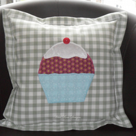 Cushions with appliquéd cupcake