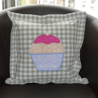 Cushion with appliquéd cupcake