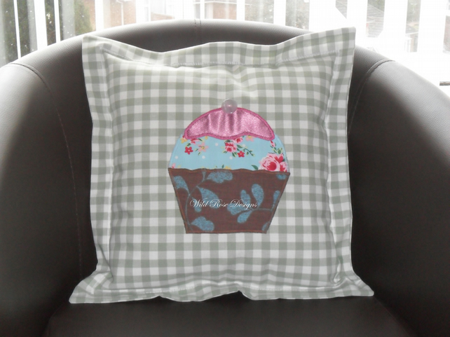 Cushions with appliqued cupcake