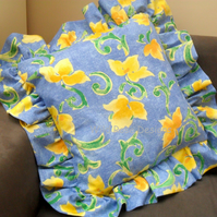 Frilled cushion in blue and yellow
