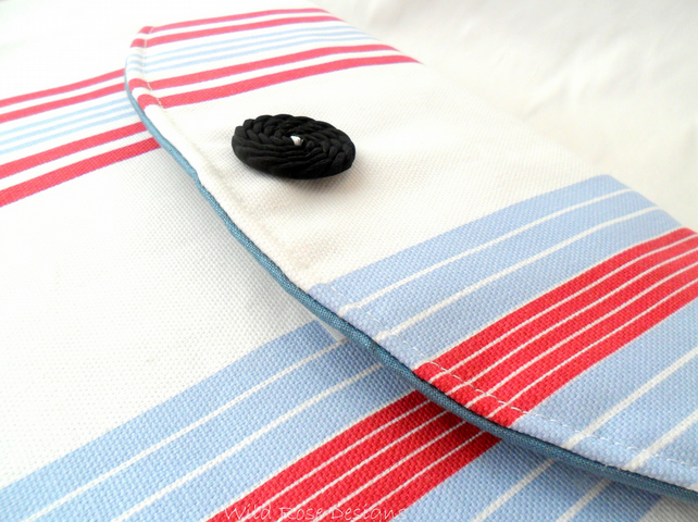 Blue, red and white striped iPad sleeve.