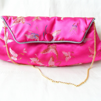 Clutch bag in pink satin