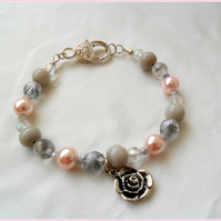 Pink and grey bead bracelet