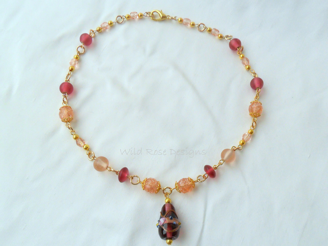 Pink and gold beaded necklace