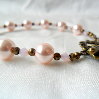 Pink and bronze beaded bracelet