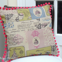 Cushion cover in a 'Patisserie' print with a pink bobble trim