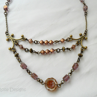 Three row purple and bronze necklace