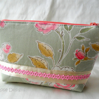 Green and pink floral print make-up bag. Cosmetic bag.
