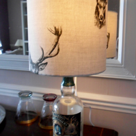 Up-cycled whisky bottle lamp with a handmade lampshade in a stag design