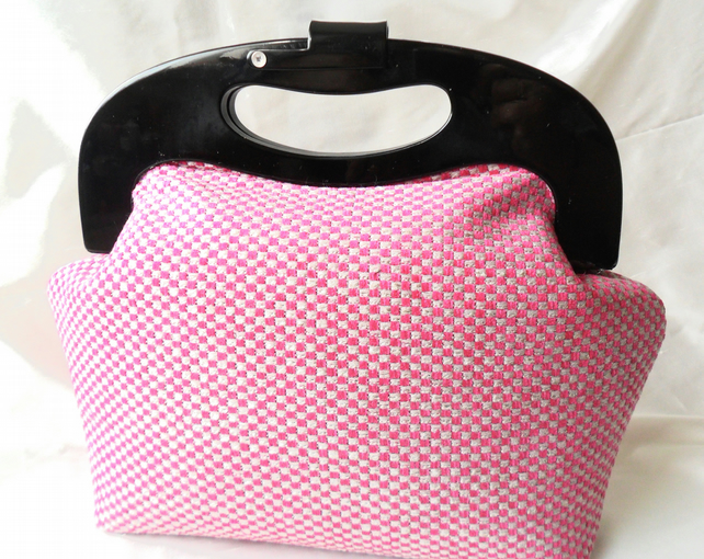 Retro style cerise handbag with black resin frame