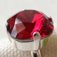 Adjustable ring with a red Swarovski crystal