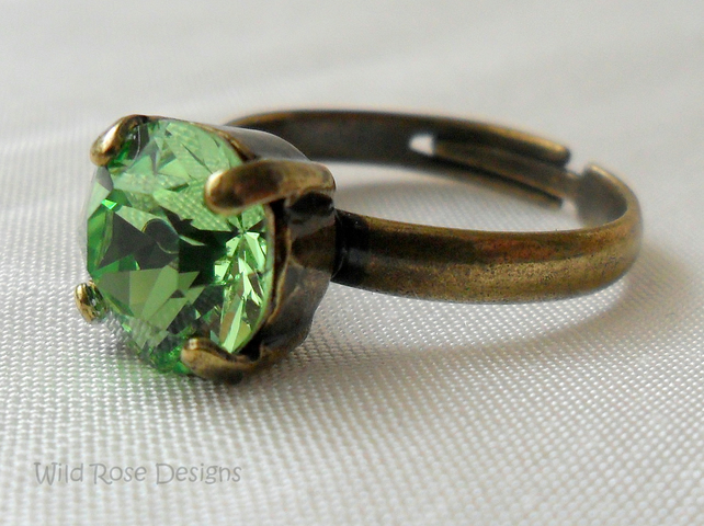 Bronze ring with a Swarovski Peridot crystal
