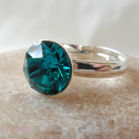 Adjustable ring with a Swarovski blue zircon
