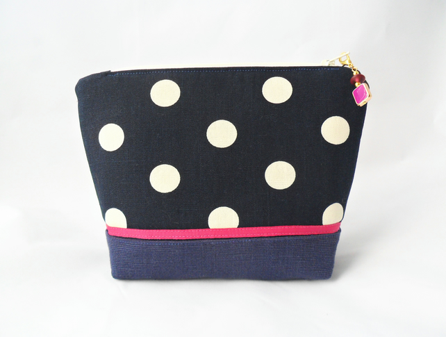 Navy and white spotted make-up bag