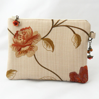 Make-up bag or zipped pouch.
