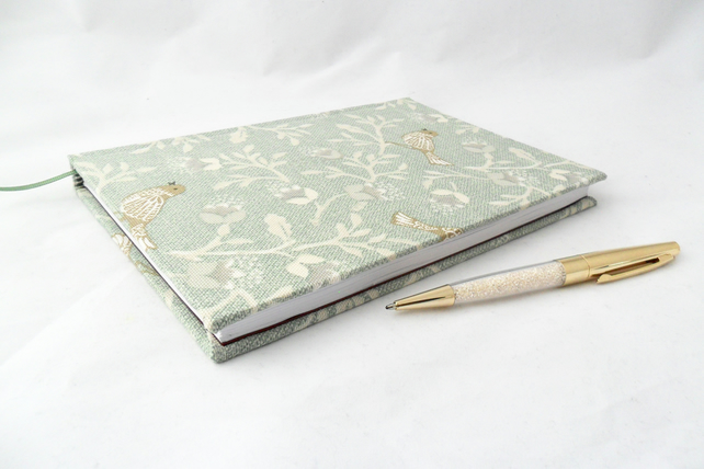 Handmade notebook with a bird print cover