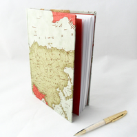 Notebook covered in a maps fabric