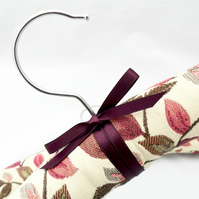 Padded coat hangers in a floral Jacquard fabric