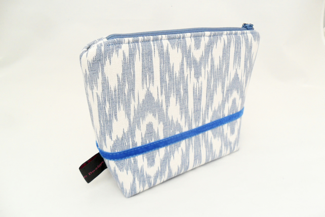 Blue makeup bag in a contemporary fabric