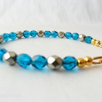 Teal and gold bead bracelet