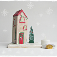 Wooden Christmas House with Christma Tree on a base