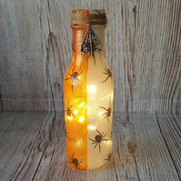 Spider Halloween Bottle, upcycled, with fairy lights.