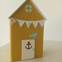 Small wooden beach hut