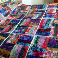 Batik fabric patchwork quilt. Single or double bed size.