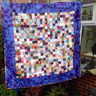 Lap quilt. Colourful scrap quilt