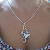 Hand drawn hovering bird statement necklace