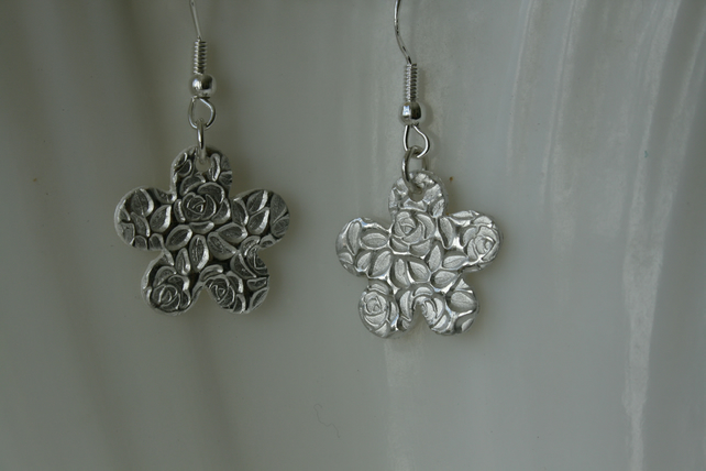 Large silver flower earrings