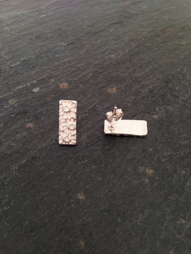 Rectangle studs with heavy floral pattern