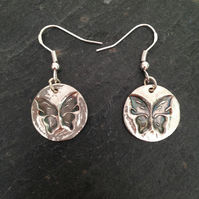 Round butterfly silver earrings