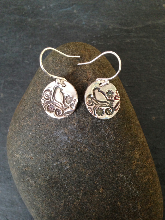 Round silver birdie earrings