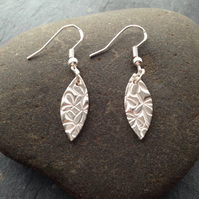 Silver oval earrings with leaf impression