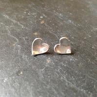 Cupped heart shape silver stud earrings