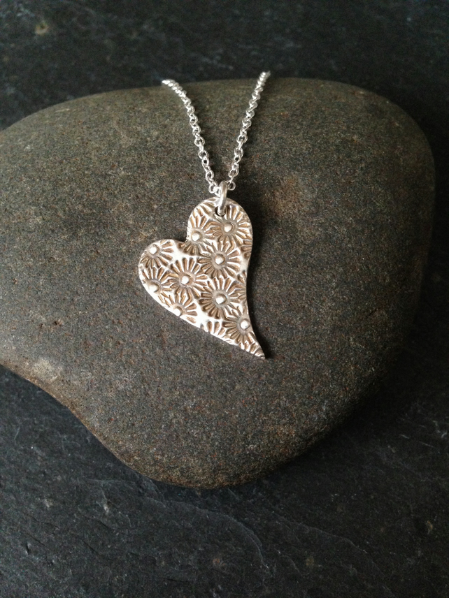 Wonky heart necklace with sunflower design