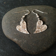 Wonky heart earrings with sunflower design