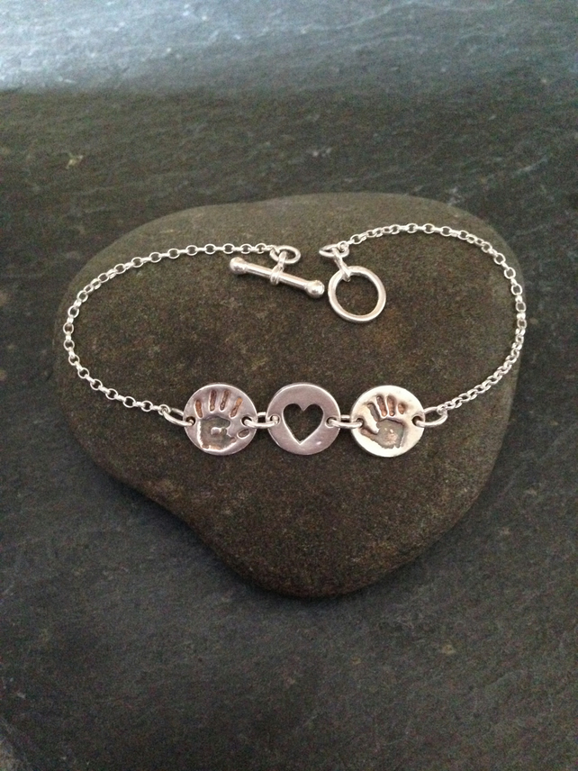 Personal touch double hand or foot print bracelet with heart connector