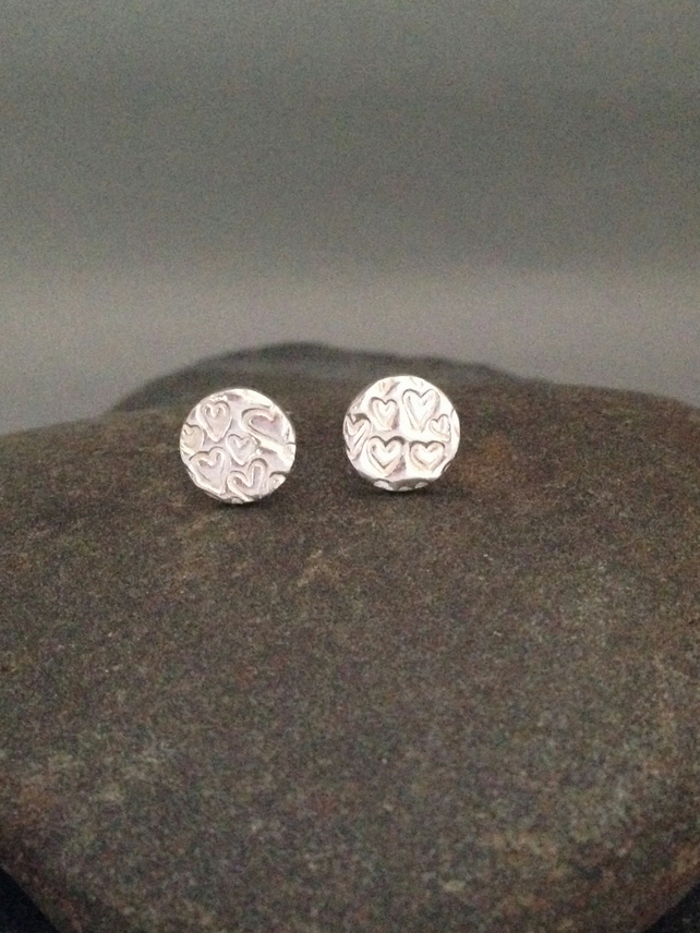 Fine silver small round studs with heart design