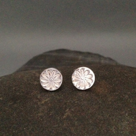 Fine silver small round earrings with flower impression