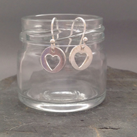 Small round silver earring with heart cut out