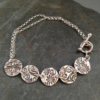 Flower and swirl silver link bracelet